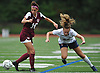 Cailey Welch #10 of North Shore, left, and Megan Sullivan of South Side jostle for position during a Nassau County AB1 varsity girls soccer game at North Shore High School on Friday, Sept. 14, 2018. South Side won by a score of 2-0.