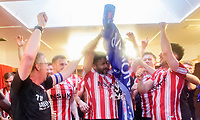 Lincoln City's Bruno Andrade, centre, celebrates in the changing room  after winning the league<br /> <br /> Photographer Chris Vaughan/CameraSport<br /> <br /> The EFL Sky Bet League Two - Lincoln City v Tranmere Rovers - Monday 22nd April 2019 - Sincil Bank - Lincoln<br /> <br /> World Copyright © 2019 CameraSport. All rights reserved. 43 Linden Ave. Countesthorpe. Leicester. England. LE8 5PG - Tel: +44 (0) 116 277 4147 - admin@camerasport.com - www.camerasport.com