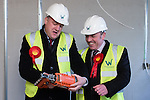 © Joel Goodman - 07973 332324 .  04/02/2014 . Manchester , UK . Ed Balls and Mike Kane with a nail gun . Ed Balls , MP for Morley and Outwood and Shadow Chancellor of the Exchequer the Labour Party , joins Labour candidate Mike Kane on the campaign trail ahead of the Wythenshawe and Sale East by-election , following the death of MP Paul Goggins . They visit apprentices at the Leybrook Road building site in Wythenshawe where apprentice builders work on bungalows built for affordable rent . Photo credit : Joel Goodman
