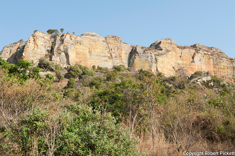 Landscape view of Sandstone rock formations, Isalo National Park, Madagascar, deep canyons, palm lined oases, and grassland