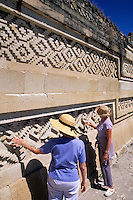 Tourists exploring the historical ruins at Mitla near Oaxaca Mexico.