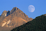 Moon rising over mountains. Grand Teton National Park, WYOMING