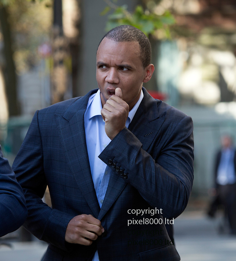 """pic shows:  Phil Ivey arrives at court with Cheng Yin Sun    - also known as """"Kelly""""  today <br /> <br /> <br /> <br /> World's number one poker star Phil Ivey arrives at the High Court in London today 3.10.14<br /> He arrived with his legal team carrying bundles of papers in his case against Crockfords casino in Mayfair, London which is owned by Gentings.<br /> <br /> The high stakes gambler who is suing Britain's oldest gaming club for withholding his £7.3million payout<br /> They claim he was """"edge counting""""<br /> <br /> He arrived with two women of Asian appearance who may be part of his legal team or involved in the case.<br /> <br /> <br /> <br /> <br /> <br /> <br /> Pic by Gavin Rodgers/Pixel 8000 Ltd"""