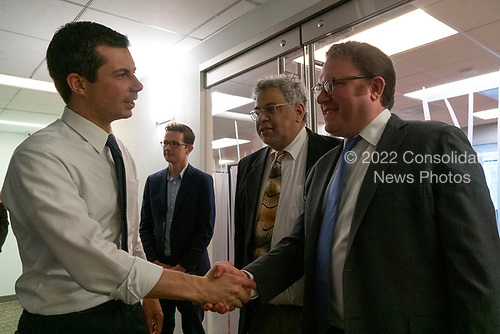 Bluelight Founders Steve Rabinowitz and Aaron Keyak greet Mayor Pete Buttigieg prior to his meeting with leaders of the Jewish community at a communal parlor meeting at the offices of Bluelight Strategies in Washington D.C., U.S. on May 23, 2019.<br /> <br /> Credit: Stefani Reynolds / CNP