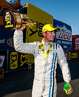 Sep 17, 2017; Concord, NC, USA; NHRA pro stock driver Tanner Gray celebrates after winning the Carolina Nationals at zMax Dragway. Mandatory Credit: Mark J. Rebilas-USA TODAY Sports