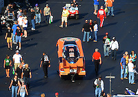Apr. 13, 2012; Concord, NC, USA: Fans surround the car of NHRA funny car driver Todd Lesenko as its towed from the pits during qualifying for the Four Wide Nationals at zMax Dragway. Mandatory Credit: Mark J. Rebilas-