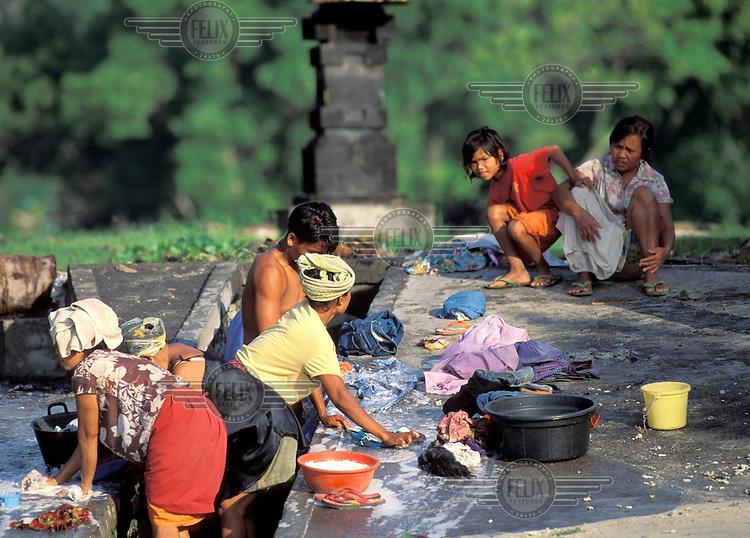 Women washing laundry.