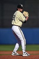 Vanderbilt Commodores pitcher Ryan Johnson (31) gets ready to deliver a pitch during a game against the Indiana State Sycamores on February 21, 2015 at Charlotte Sports Park in Port Charlotte, Florida.  Indiana State defeated Vanderbilt 8-1.  (Mike Janes/Four Seam Images)