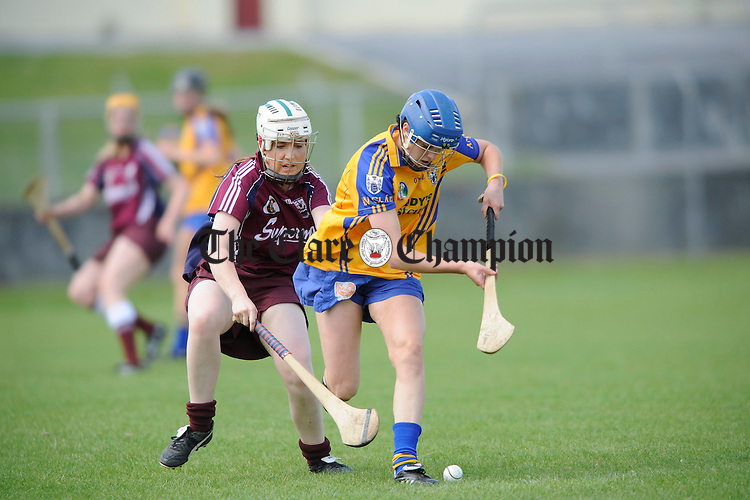 Clare's Roisin O Brien contest's the ball with Galway's Jennifer Coone during their Intermediate championship game at Athentry. Photograph by John Kelly.