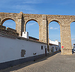 Historic 16th century Aqueduct,  Aqueduto da Agua de Prata, designed by Francisco de Arruda completed in 1530s, incorporating streest and houses developed within its structure, city of Evora, Alto Alentejo, Portugal, southern Europe