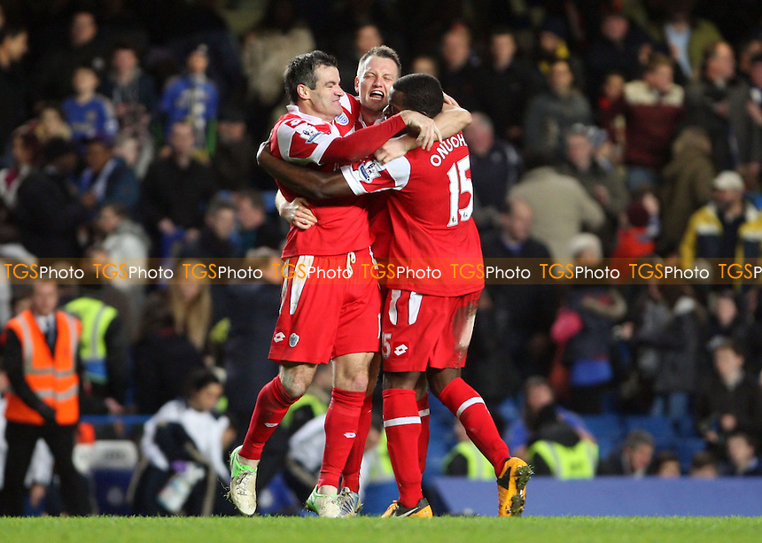 Ryan Nelsen, Clint Hill and Nedum Onuoha of QPR celebrate at the end of the game - Chelsea vs Queens Park Rangers, Barclays Premier League at Stamford Bridge, Chelsea - 02/01/13 - MANDATORY CREDIT: Rob Newell/TGSPHOTO - Self billing applies where appropriate - 0845 094 6026 - contact@tgsphoto.co.uk - NO UNPAID USE.