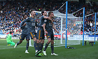 Leicester City's Jamie Vardy celebrates scoring his second and side's fourth goal with team-mates Ben Chilwell and James Maddison <br /> <br /> Photographer Stephen White/CameraSport<br /> <br /> The Premier League - Huddersfield Town v Leicester City - Saturday 6th April 2019 - John Smith's Stadium - Huddersfield<br /> <br /> World Copyright © 2019 CameraSport. All rights reserved. 43 Linden Ave. Countesthorpe. Leicester. England. LE8 5PG - Tel: +44 (0) 116 277 4147 - admin@camerasport.com - www.camerasport.com