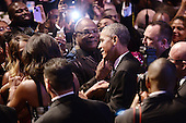 United States President Barack Obama and first lady Michelle Obama shake hands with guests at the Congressional Black Caucus Foundation Annual Phoenix Awards dinner at the Walter E. Washington Convention Center, September 27, 2014 in Washington, DC. The CBC's annual conference brings together activists, politicians and business leaders to discuss public policy impacting Black communities in America and abroad. <br /> Credit: Olivier Douliery / Pool via CNP