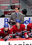 26 October 2009: Montreal Canadiens Head Coach Jacques Martin looks out from behind the bench during a game against the New York Islanders at the Bell Centre in Montreal, Quebec, Canada. The Canadiens defeated the Islanders 3-2 in sudden death overtime for their 4th consecutive win. Mandatory Credit: Ed Wolfstein Photo