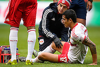 Tim Cahill (17) of the New York Red Bulls gets examined by a trainer before leaving the field with an injury during the first half against Chivas USA during a Major League Soccer (MLS) match at Red Bull Arena in Harrison, NJ, on March 30, 2014.