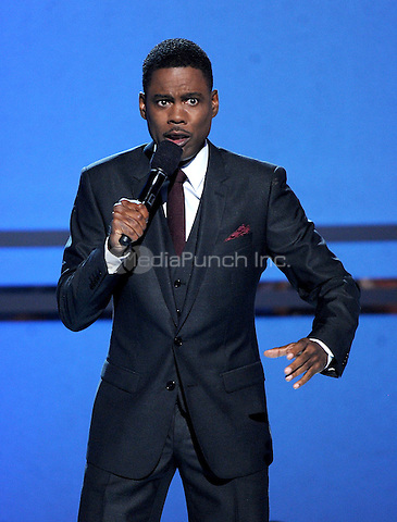 LOS ANGELES, CA - JUNE 29 : Host Chris Rock onstage at the BET Awards '14 at Nokia Theatre L.A. Live on June 29, 2014 in Los Angeles, California. Credit: PGMicelotta/MediaPunch
