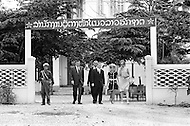 Vientiane, Laos. April 1970. Businessman Ross Perot (C), founder of Electronic Data Systems, Inc., meets with the Pathet Lao ambassador at the embassy in Vientiane, North Vietnam after visiting a Prisoners of War camp. Perot was appointed by United States Secretary of the Navy John Warner to report on the conditions of Americans in Vietnamese and Laotian POW camps for four years, until the prisoners were released in 1972 at the end of the Vietnam War.