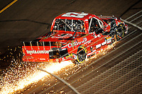 Nov. 7, 2008; Avondale, AZ, USA; Nascar Craftsman Truck Series driver Johnny Benson blows a tire during the Lucas Oil 150 at Phoenix International Raceway. Mandatory Credit: Mark J. Rebilas-