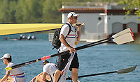 Banyoles, SPAIN,  GBR coach Paul REEDY carrying a single scull   FISA World Cup Rd 1. Lake Banyoles  Thursday,  28/05/2009   [Mandatory Credit. Peter Spurrier/Intersport Images]