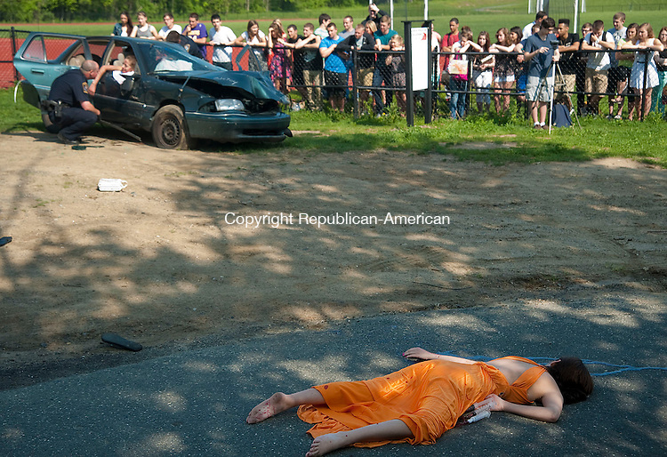 PLYMOUTH CT 21 MAY 2013--052113JS01-Brook LeGassy, foreground, portrayed a deceased accident victim during a mock DUI crash Tuesday at Terryville High School in Plymouth. Students from the drama club portrayed the victims as members of the Plymouth Police, Fire and EMT ran through the scenario to help educate the students of the dangers of drinking and driving as prom and graduation season is upon them. .Jim Shannon Republcan-American