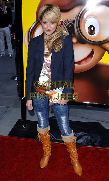 ASHLEY TISDALE.The Universal Pictures' World Premiere of Curious George held at The Arclight Theatre in Hollywood, California  .January 28th, 2006.Ref: DVS.full length jeans denim tucked into brown boots blue jacket clutch purse.www.capitalpictures.com.sales@capitalpictures.com.Supplied By Capital PIctures