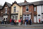 Fans of Crewe Alexandra and Aldershot Town standing outside the famous fish and chip shop outside the Alexandra Stadium prior to the teams' League 2 match.. The visitors won by 2 goals to 1.
