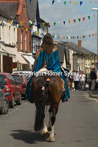 Giffords circus, a horse rider parades through the town. The Hay Festival, Hay on Wye, Powys, Wales, Great Britain. 2006.