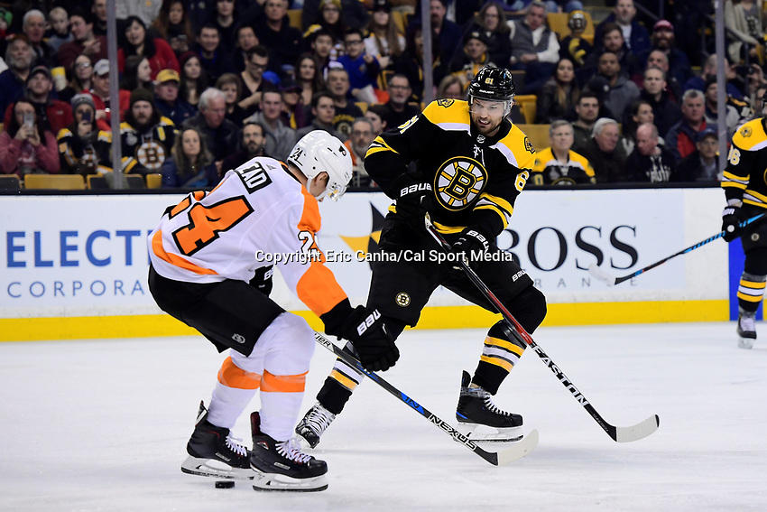 March 8, 2018: Boston Bruins left wing Rick Nash (61) passes the puck through the feet of Philadelphia Flyers right wing Matt Read (24) during the NHL game between the Philadelphia Flyers and the Boston Bruins held at TD Garden, in Boston, Mass. Boston defeats Philadelphia 3-2 in regulation time. Eric Canha/CSM