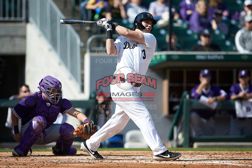 Bobby Seymour (3) of the Wake Forest Demon Deacons follows through on his swing against the Furman Paladins at BB&T BallPark on March 2, 2019 in Charlotte, North Carolina. The Demon Deacons defeated the Paladins 13-7. (Brian Westerholt/Four Seam Images)