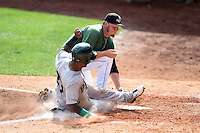 Clinton LumberKings pitcher Aaron Brooks (50) attempts to tag B.J. Boyd (23) scoring a run on a wild pitch during a game against the Beloit Snappers on August 17, 2014 at Ashford University Field in Clinton, Iowa.  Clinton defeated Beloit 4-3.  (Mike Janes/Four Seam Images)