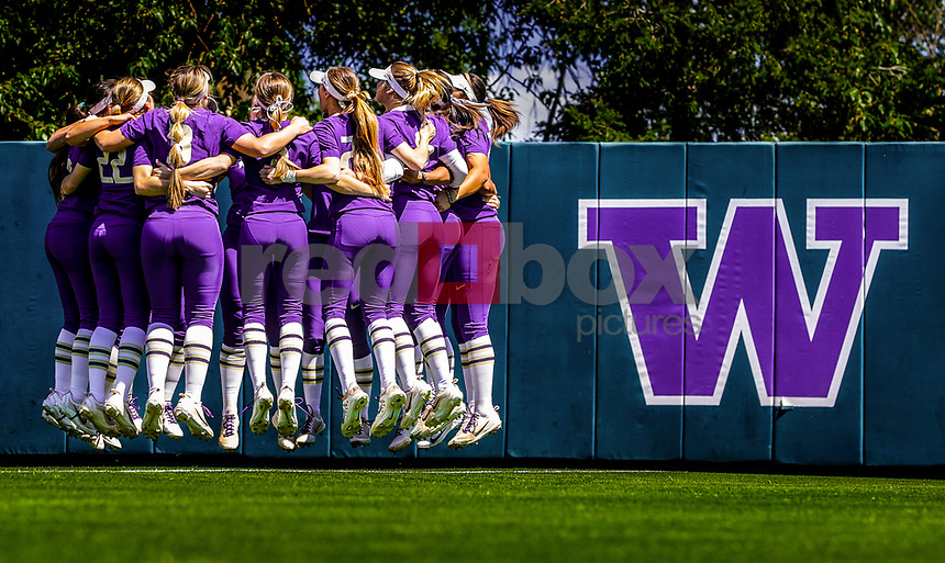 The University of Washington softball team defeats the University of Michigan 12-4 in the second game of the NCAA tournament on May 19, 2017. (Photography by Scott Eklund/Red Box Pictures)