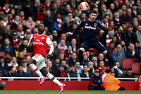 7th March 2020; Emirates Stadium, London, England; English Premier League Football, Arsenal versus West Ham United; Aaron Cresswell of West Ham United heads the ball away from Nicolas Pepe of Arsenal