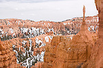 The snow covered red hoodoos and cliffs of Bryce Canyon National Park, Utah, United States of America.