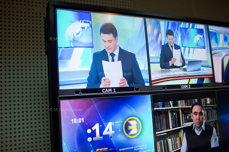 Monitors show camera views and other stations during a live broadcast of news in native Bashkir language (top left) at Teletsentr in Ufa, Bashkortostan, Russia.