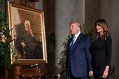 President Donald Trump and first lady Melania Trump walk past a painting of the late Supreme Court Justice John Paul Stevens after they pay their respects as he lies in repose in the Great Hall of the Supreme Court in Washington, Monday, July 22, 2019. <br /> Credit: Andrew Harnik / Pool via CNP