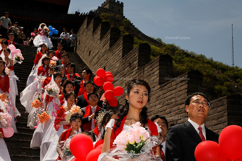 Mass wedding at Great Wall..Contact is:..Sophie.+86 135 0122 1600