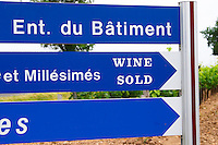 A blue road sign saying 'Wine Sold' with Pomerol vineyards in the background Pomerol Bordeaux Gironde Aquitaine France