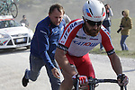 Luca Paolini (ITA) Team Katusha gets a push from his mechanic after a wheel change on the 7th sector of strade the climb of Monte Sante Maria during the 2014 Strade Bianche race over the white dusty gravel roads of Tuscany running 200km from San Gimignano to Siena, Italy. 8th March 2014.<br /> Picture: Eoin Clarke www.newsfile.ie