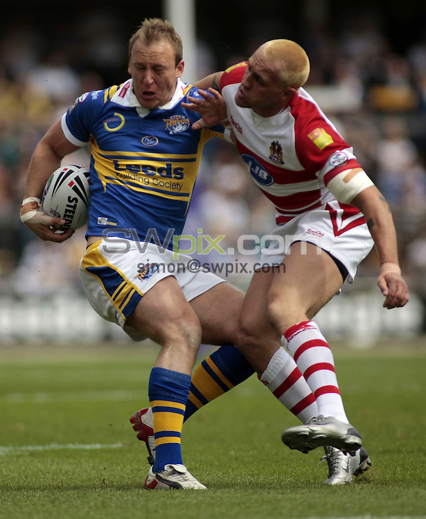 Pix: Ben Duffy/SWpix.com. Rugby League Carnegie Challenge Cup, Leeds Rhinos v Wigan Warriors....31/05/2008...copyright picture>>simon wilkinson>>07811 267 706>>..Leed's Carl Ablett is caught by Wigan's Gareth Hock.