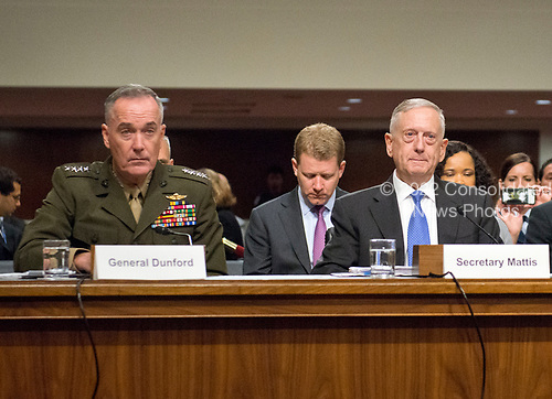 "United States Secretary of Defense James N. Mattis, right, and General Joseph F. Dunford, Jr., US Marine Corps, Chairman of the Joint Chiefs of Staff, left, give testimony before the US Senate Committee on Armed Services on ""the Department of Defense budget posture in review of the Defense Authorization Request for Fiscal Year 2018 and the Future Years Defense Program"" on Capitol Hill in Washington, DC on Tuesday, June 13, 2017.<br /> Credit: Ron Sachs / CNP"