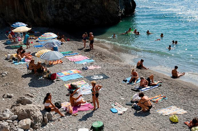 Sunbaking on the beach of Castiglione, on the Amalfi Coast, Italy