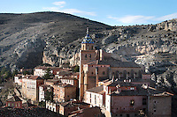 General view of Cathedral, Albarracin, Teruel, Spain, on February 13, 2006, pictured in the morning. The Cathedral, 1572-1600, was built by Martin de Castaneda, Pierres Vedel, and Alonso del Barrio de Ajo, in the Levantine Gothic style. At the top of the village is the 10th century Moorish castle, reached through cobbled streets of  houses constructed of wood and plaster with small windows. Albarracin, a beautiful village with National Monument status overlooking the Guadalivar River, lies 28 km from Teruel, in the National Park in the Montes Universales. It is on the border of three Spanish Kingdoms: Castille, Aragon and Valencia, has been occupied for hundreds of years and is known as the Eagles` Nest because it  is built on a steep outcrop of rock surrounded by a deep gorge, a natural defence. Its buildings show  Moorish influence and even the name may derive from  the Berber clan Banu Razin who settled in the area during the 9th century. Picture by Manuel Cohen.