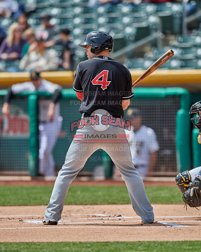 Jamie Romak (4) of the El Paso Chihuahuas at bat against the Salt Lake Bees in Pacific Coast League action at Smith's Ballpark on April 30, 2017 in Salt Lake City, Utah.   El Paso defeated Salt Lake 3-0. This was Game 1 of a double-header.(Stephen Smith/Four Seam Images)