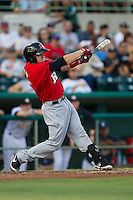 Frisco Roughriders third baseman Ryan Rua (15) swings the bat in the Texas League baseball game against the San Antonio Missions on August 22, 2013 at the Nelson Wolff Stadium in San Antonio, Texas. Frisco defeated San Antonio 2-1. (Andrew Woolley/Four Seam Images)