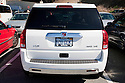 Rear view of white California 'ECO GEM' personalized license plate on Saturn Vue AWD V6 SUV. People pay for the customized plates and the proceeds support various causes. The fees collected for these Yosemite Foundation License Plates, featuring a famous view of Yosemite Valley and Half Dome, support the Yosemite Fund environmental projects. California, USA
