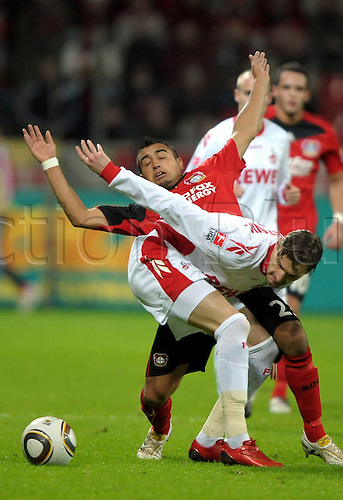 Leverkusen's Arturo Vidal (back) fights for the ball with Cologne's Milivoje Novakovic during the Bundesliga match Bayer 04 Leverkusen vs 1. FC Cologne at ByArena stadium in Leverkusen, Germany, 27 February 2010. The match ended in a goalless draw. Photo: Franz-Peter Tschauner /Actionplus. Editorial Use UK.