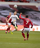 7th July 2020; City Ground, Nottinghamshire, Midlands, England; English Championship Football, Nottingham Forest versus Fulham; Harrison Reed of Fulham rises for the ball as Lewis Grabban of Notts Forest watches on