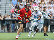 Baltimore, MD - April 28, 2018: Maryland Terrapins Bubba Fairman (2) runs past Johns Hopkins Blue Jays Daniel Jones (23) during game between John Hopkins and Maryland at  Homewood Field in Baltimore, MD.  (Photo by Elliott Brown/Media Images International)