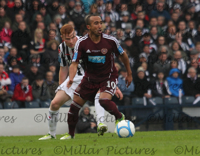 Mehdi Taouil tracked by Conor Newton in the St Mirren v Heart of Midlothian Scottish Communities League Cup Final match played at Hampden Park, Glasgow on 17.3.13.