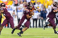Landover, MD - SEPT 3, 2017: Virginia Tech Hokies quarterback Josh Jackson (17) avoids defenders during game between West Virginia and Virginia Tech at FedEx Field in Landover, MD. (Photo by Phil Peters/Media Images International)